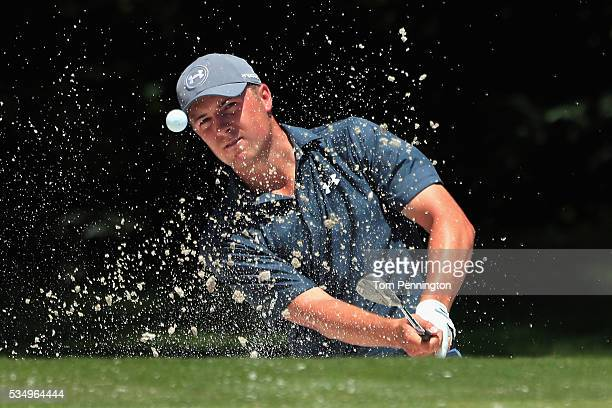 Jordan Spieth hits a shot out of the bunker on the fifth hole during the Third Round of the DEAN DELUCA Invitational at Colonial Country Club on May...