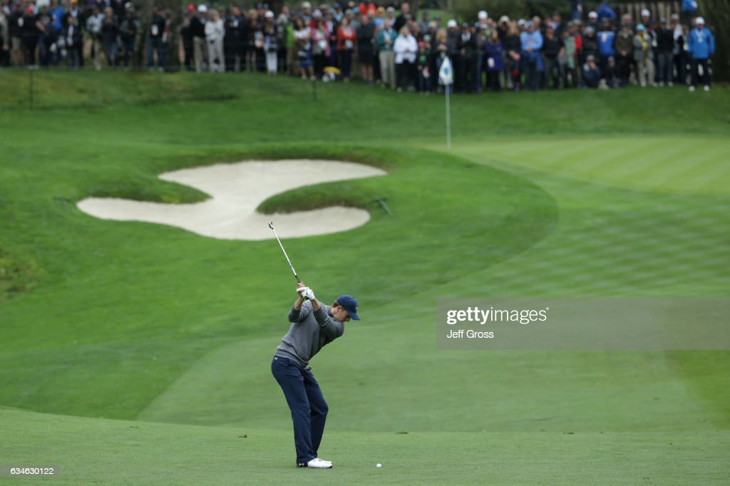 Jordan Spieth hits an approach shot on the 14th hole during Round Two of the AT&T Pebble Beach Pro-Am at Spyglass Hill Golf Course on February 10, 2017 in Pebble Beach, California.