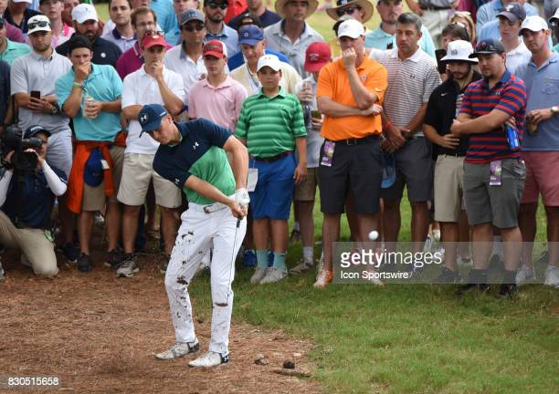 Jordan Spieth hits an iron out from a natural area on the 10th hole during the second round of the PGA Championship on August 11 2017 at Quail Hollow...