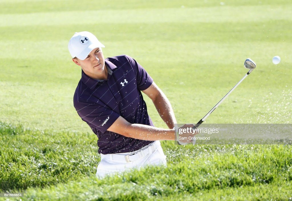 Jordan Spieth hits from a bunker on the 16th hole during the second round of the Memorial Tournament at Muirfield Village Golf Club on June 2, 2017 in Dublin, Ohio.
