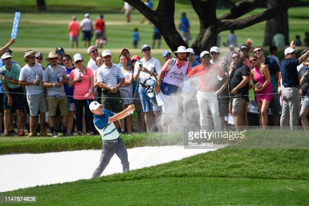 Jordan Spieth hits from a bunker on the fifteenth hole during the final round of the Charles Schwab Challenge at Colonial Country Club on May 26 2019...