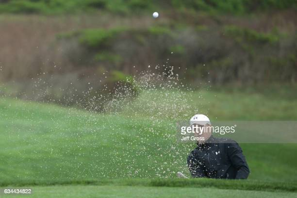 Jordan Spieth hits from the bunker on the 12th hole during Round One of the ATT Pebble Beach ProAm at Monterey Peninsula Country Club on February 9...