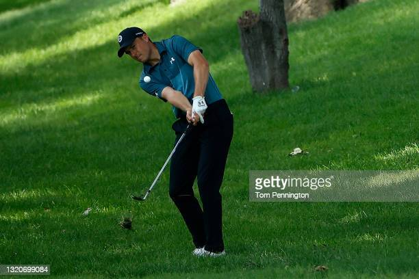 Jordan Spieth hits from the rough on the fifth hole during the third round of the Charles Schwab Challenge at Colonial Country Club on May 29, 2021...
