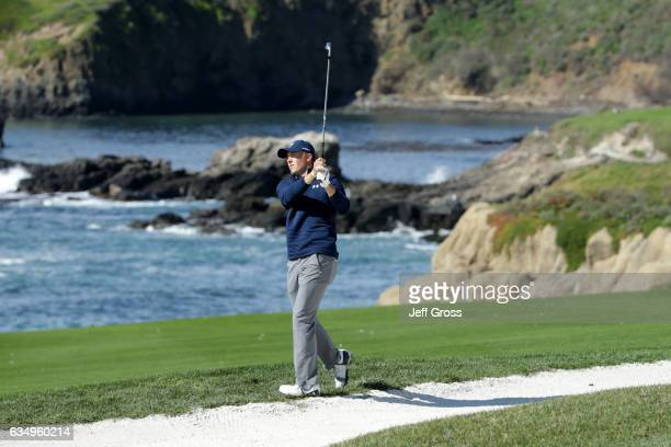 Jordan Spieth hits his second shot on the 10th hole during the Final Round of the ATT Pebble Beach ProAm at Pebble Beach Golf Links on February 12...