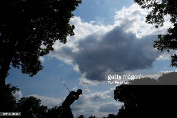 Jordan Spieth hits his tee shot on the 13th hole during the third round of the Charles Schwab Challenge at Colonial Country Club on May 29, 2021 in...