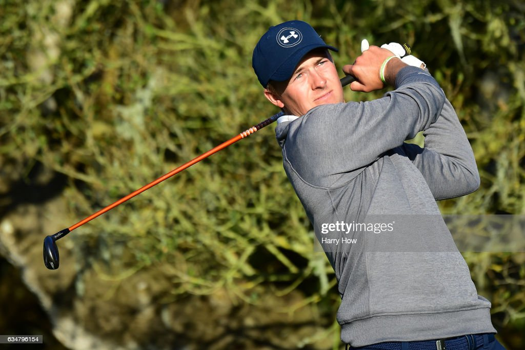 Jordan Spieth hits his tee shot on the 16th hole during Round Three of the AT&T Pebble Beach Pro-Am at Pebble Beach Golf Links on February 11, 2017 in Pebble Beach, California.