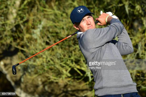 Jordan Spieth hits his tee shot on the 16th hole during Round Three of the ATT Pebble Beach ProAm at Pebble Beach Golf Links on February 11 2017 in...