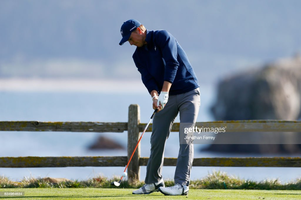 Jordan Spieth hits his tee shot on the 18th hole during the Final Round of the AT&T Pebble Beach Pro-Am at Pebble Beach Golf Links on February 12, 2017 in Pebble Beach, California.