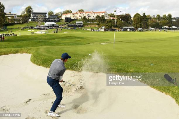 Jordan Spieth hits out of the bunker on the 10th hole green during the final round of the Genesis Open at Riviera Country Club on February 17, 2019...