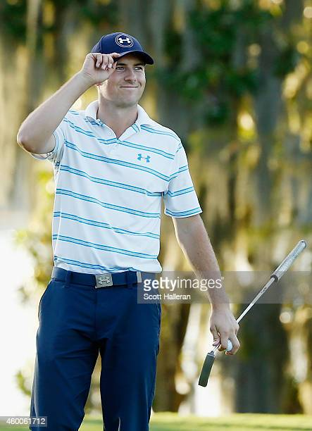 Jordan Spieth holes a long birdie putt on the 18th green to shoot a nine-under par 63 during the third round of the Hero World Challenge at the...