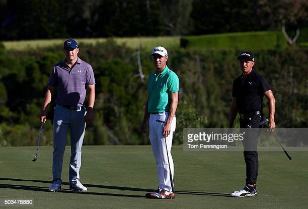 Jordan Spieth Justin Thomas and Rickie Fowler putt during practice rounds prior to the Hyundai Tournament of Champions at the Plantation Course at...