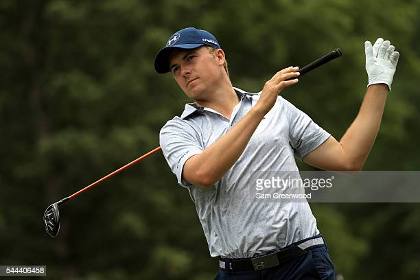 Jordan Spieth lets go of his club while hitting off the third tee during the final round of the World Golf Championships Bridgestone Invitational at...