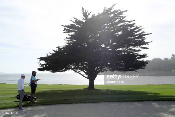 Jordan Spieth lines up a shot on the 18th hole during Round Three of the ATT Pebble Beach ProAm at Pebble Beach Golf Links on February 10 2018 in...