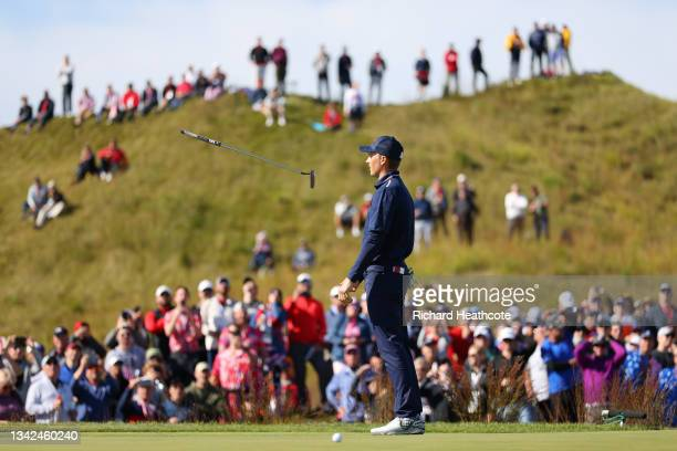 Jordan Spieth of team United States reacts after missing a putt on the 14th green during Saturday Morning Foursome Matches of the 43rd Ryder Cup at...