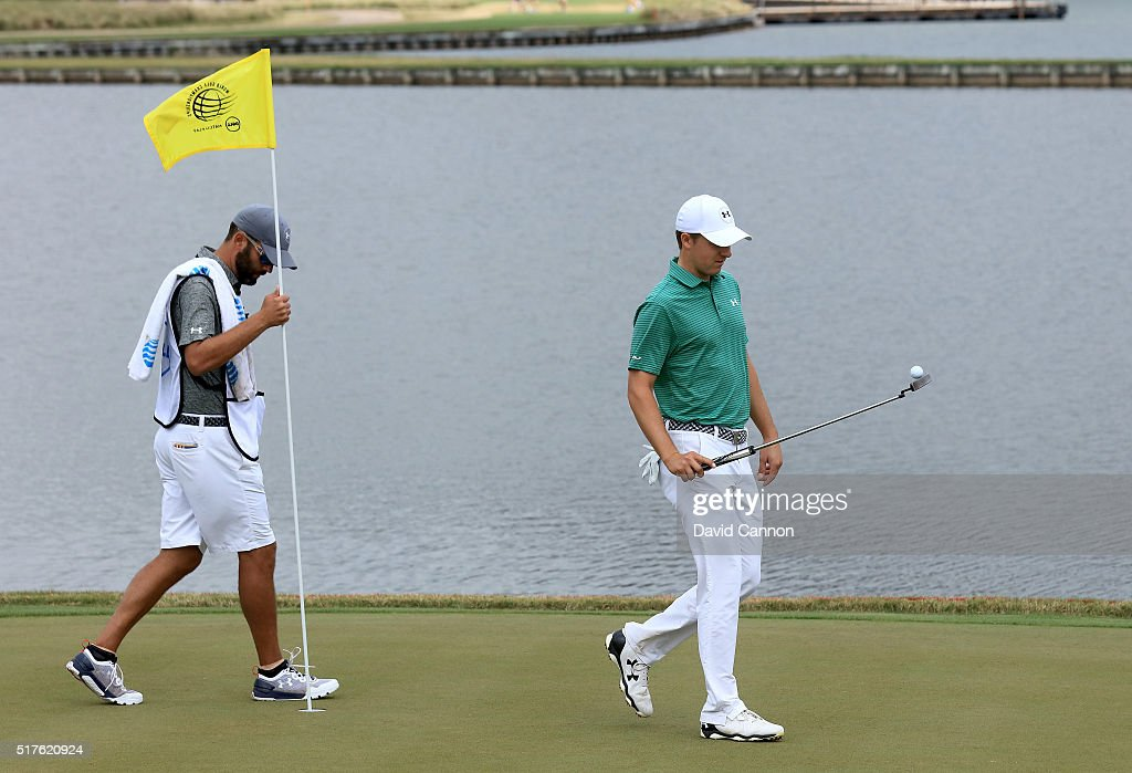 Jordan Spieth of the United and his caddie Michael Greller walk off the 13th green during the round of 16 in the World Golf Championships-Dell Match Play at the Austin Country Club on March 26, 2016 in Austin, Texas.