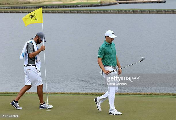 Jordan Spieth of the United and his caddie Michael Greller walk off the 13th green during the round of 16 in the World Golf Championships-Dell Match...