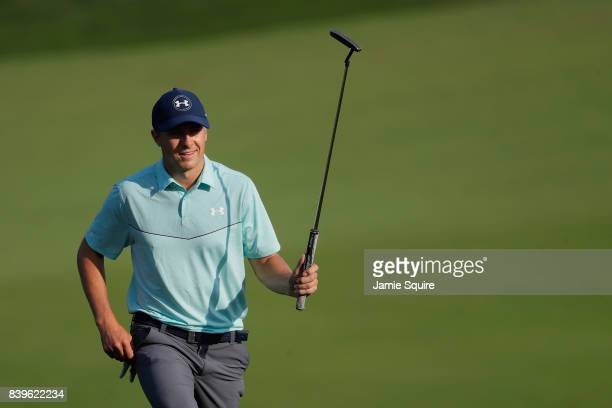 Jordan Spieth of the United States acknowledges fans as he walks onto the 18th green during round three of The Northern Trust at Glen Oaks Club on...