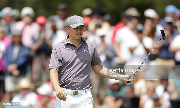 Jordan Spieth of the United States acknowledges the crowd after making a birdie on the 7th hole during day two of the Australian Open at the...