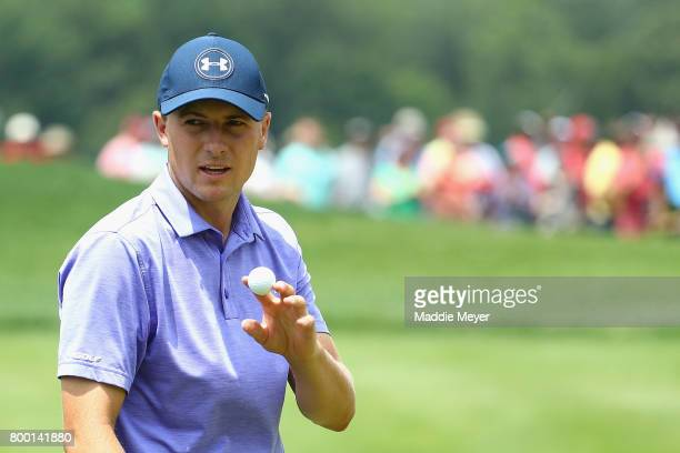 Jordan Spieth of the United States acknowledges the crowd after putting on the ninth green during the second round of the Travelers Championship at...