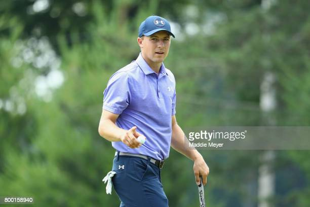 Jordan Spieth of the United States acknowledges the crowd after putting on the eighth green during the second round of the Travelers Championship at...