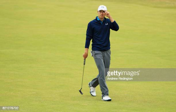 Jordan Spieth of the United States acknowledges the crowd as he walks onto the 18th green during the final round of the 146th Open Championship at...