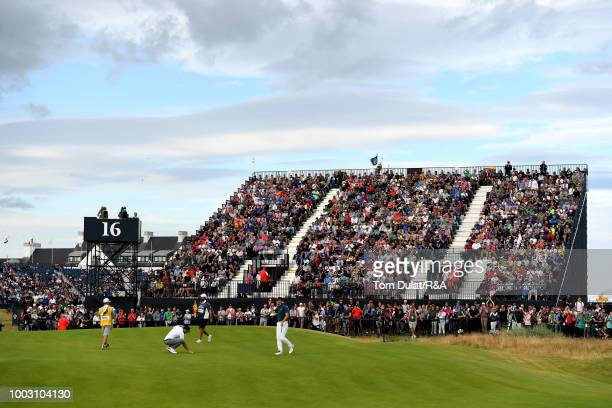 Jordan Spieth of the United States acknowledges the crowd by the 16th green during round three of the Open Championship at Carnoustie Golf Club on...