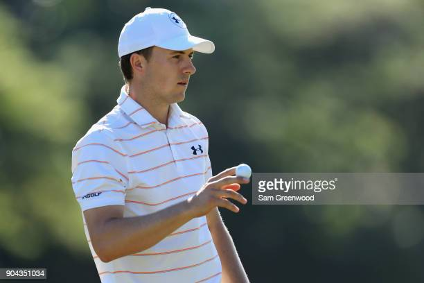 Jordan Spieth of the United States acknowledges the crowd on the tenth green during round two of the Sony Open In Hawaii at Waialae Country Club on...