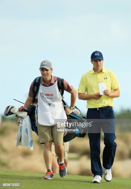 Jordan Spieth of the United States and caddie Eric Leyendecker walk during the second round of the Hero World Challenge at Albany Bahamas on December...