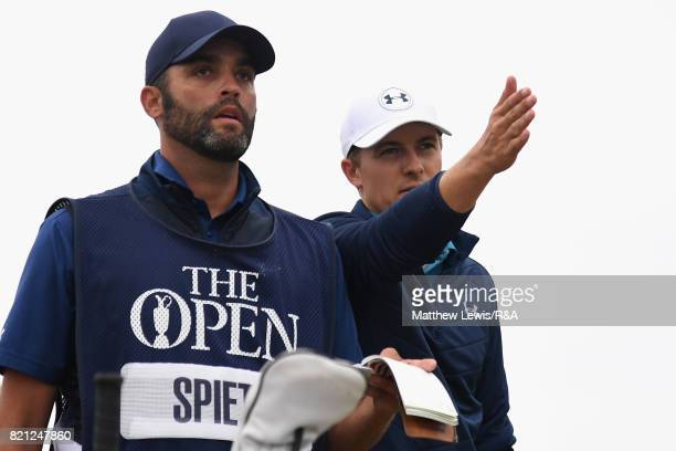 Jordan Spieth of the United States and caddie Michael Greller discuss the playing line for his third shot on the 13th hole during the final round of...