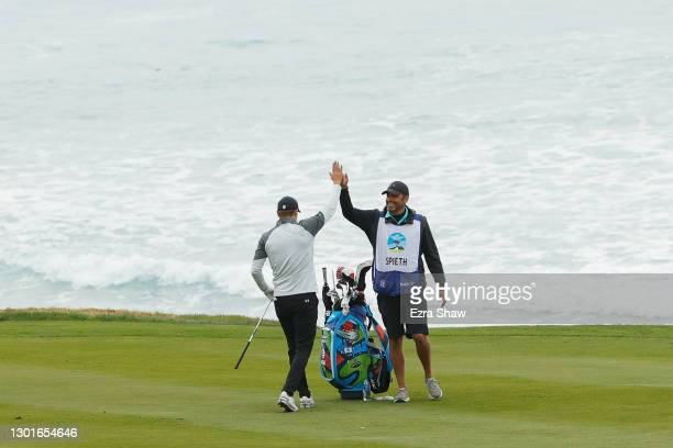 Jordan Spieth of the United States and caddie Michael Greller during the first round of the AT&T Pebble Beach Pro-Am at Pebble Beach Golf Links on...