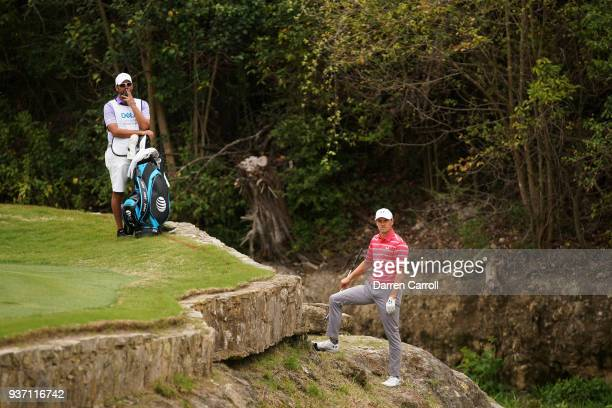 Jordan Spieth of the United States and caddie Michael Greller stand on the third hole during the third round of the World Golf Championships-Dell...