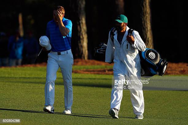Jordan Spieth of the United States and caddie Michael Greller walk to the 18th green during the final round of the 2016 Masters Tournament at Augusta...