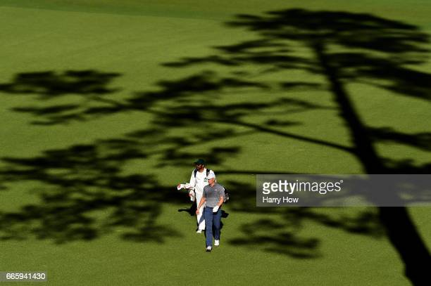 Jordan Spieth of the United States and caddie Michael Greller walk to the 14th tee during the second round of the 2017 Masters Tournament at Augusta...