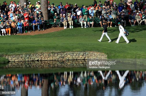 Jordan Spieth of the United States and caddie Michael Greller walk to the 15th green during the final round of the 2018 Masters Tournament at Augusta...