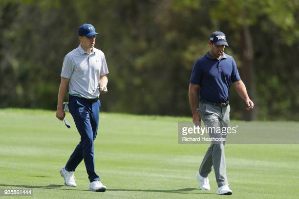 Jordan Spieth of the United States and Charl Schwartzel of South Africa walk on the third hole during the first round of the World Golf...