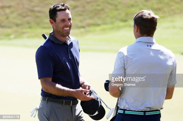 Jordan Spieth of the United States and Charl Schwartzel of South Africa react after Spieth defeated Schwartzel 31 on the 17th green during the first...