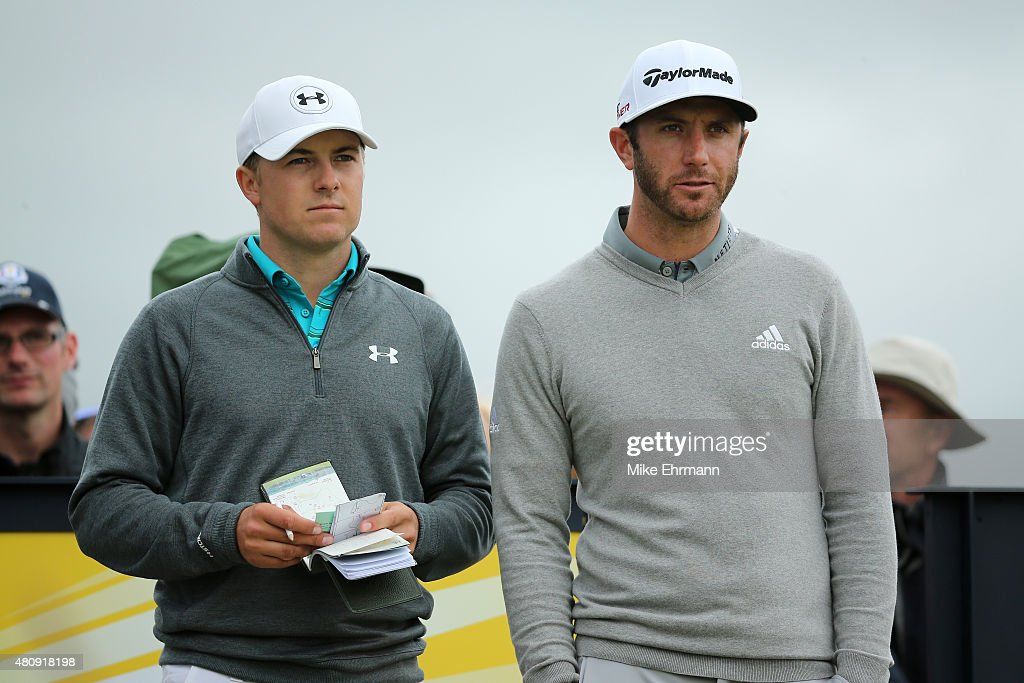 Jordan Spieth of the United States and Dustin Johnson of the United States stand together during the first round of the 144th Open Championship at The Old Course on July 16, 2015 in St Andrews, Scotland.