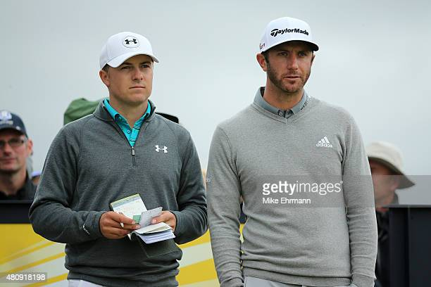 Jordan Spieth of the United States and Dustin Johnson of the United States stand together during the first round of the 144th Open Championship at...