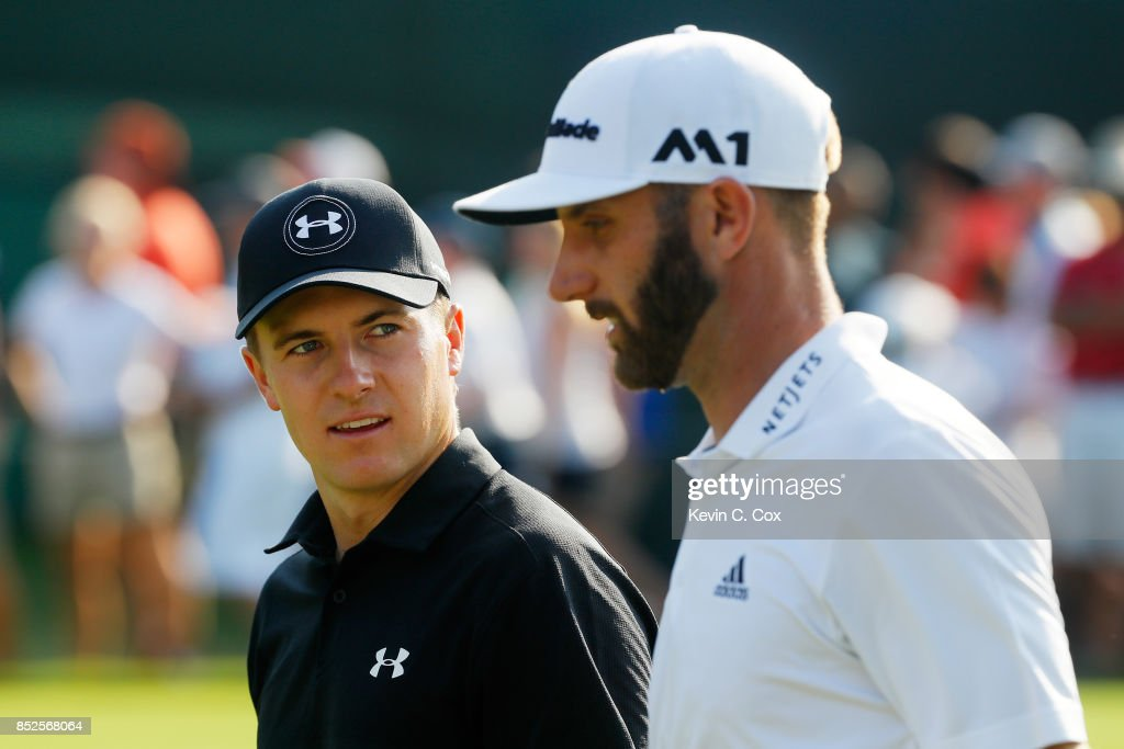 Jordan Spieth of the United States and Dustin Johnson of the United States walk on the 18th hole during the third round of the TOUR Championship at East Lake Golf Club on September 23, 2017 in Atlanta, Georgia.