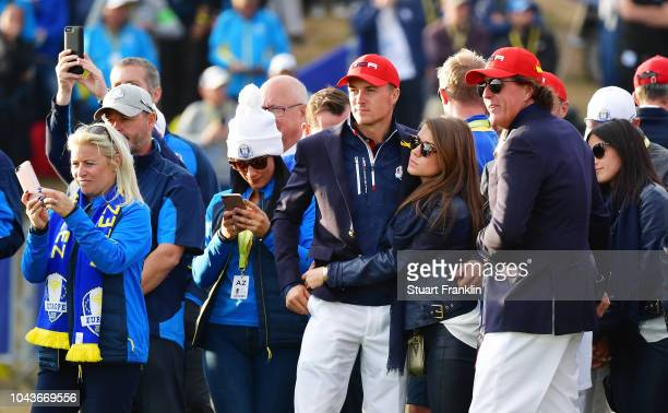 Jordan Spieth of the United States and fiance Annie Verret react following defeat during singles matches of the 2018 Ryder Cup at Le Golf National on...