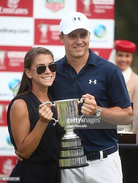 Jordan Spieth of the United States and girlfriend Annie Verret pose with the Stonehaven trophy after winning the 2016 Australian Open during day four...