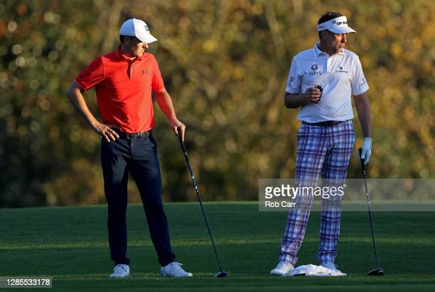 Jordan Spieth of the United States and Ian Poulter of England wait to tee off on the eighth tee during the second round of the Masters at Augusta...