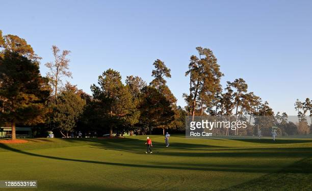 Jordan Spieth of the United States and Ian Poulter of England walk off the eighth tee during the second round of the Masters at Augusta National Golf...