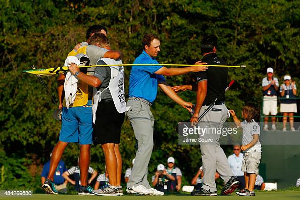 Jordan Spieth of the United States and Jason Day of Australia hug as Dash Day approaches after Day won the final round of the 2015 PGA Championship...