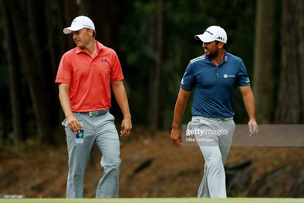 Jordan Spieth of the United States (L) and Jason Day of Australia walk together up the tenth fairway during the second round of THE PLAYERS Championship at the Stadium course at TPC Sawgrass on May 13, 2016 in Ponte Vedra Beach, Florida.