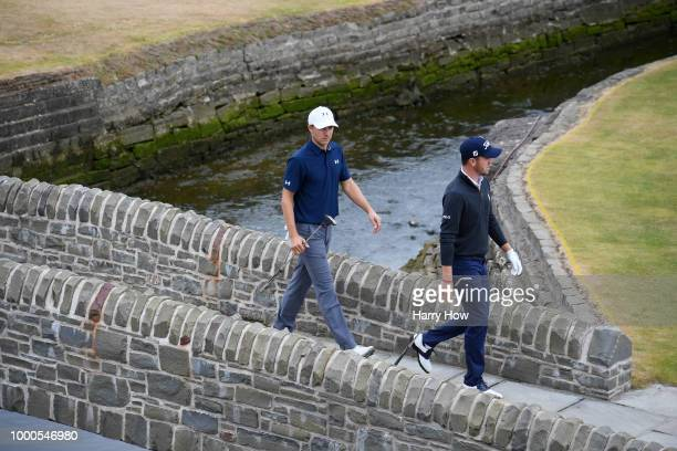 Jordan Spieth of the United States and Justin Thomas of the United States cross a bridge on the 18th hole during previews to the 147th Open...