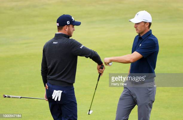 Jordan Spieth of the United States and Justin Thomas of the United States fist bump on the 18th hole during previews to the 147th Open Championship...