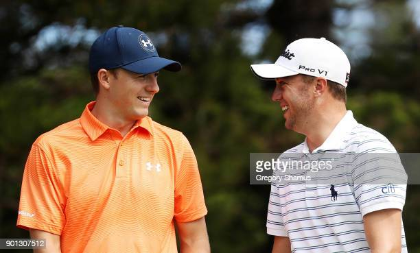 Jordan Spieth of the United States and Justin Thomas of the United States walk to the second tee during the first round of the Sentry Tournament of...