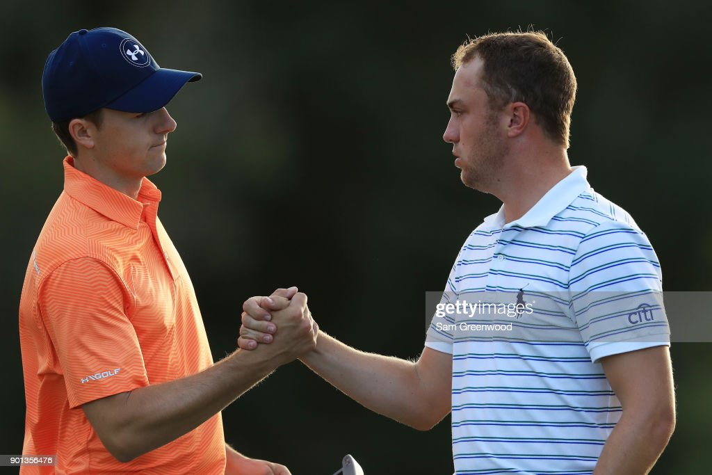 Jordan Spieth of the United States and Justin Thomas of the United States shake hands on the 18th green after finishing the first round of the Sentry Tournament of Champions at Plantation Course at Kapalua Golf Club on January 4, 2018 in Lahaina, Hawaii.