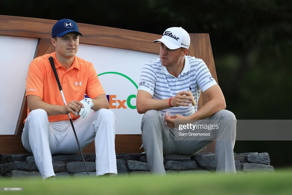 Jordan Spieth of the United States and Justin Thomas of the United States talk on the 18th tee during the first round of the Sentry Tournament of Champions at Plantation Course at Kapalua Golf Club on January 4, 2018 in Lahaina, Hawaii.